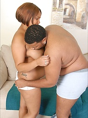A naked big black woman (BBW) stripped-off and wildly exposed her big black fat pussy