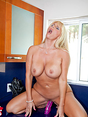 Blonde housewife bangs her pussy with a dildo while her hubby is out