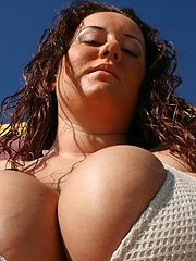 Her oversized breasts can exploding in tight bikini