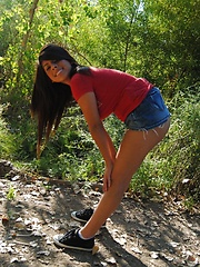 Pretty latina girl take off her red t-shirt and jeans skirt