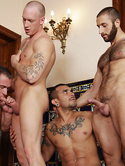 Hunk with tattoed chest takes three cock at same time