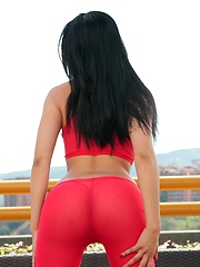 Natalia Spice is on her roof top taking off her hot pink pants
