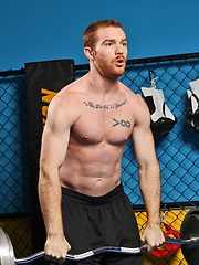 Sporty redhead dude workout in the gym