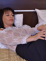 Hot MILF playing on her bed