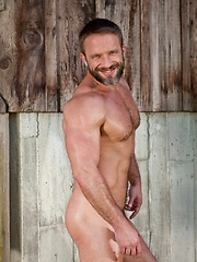 Bearded gay dad posing on the pickup