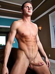 Young gay stud solo posing