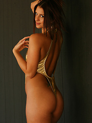 Amber dazzles in a shiny gold one piece that shows off her perfect ass