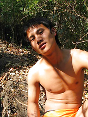 Handsome Thai guy gets naked in the wild