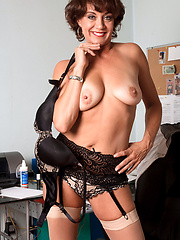 Older mature Jamy posing in the office