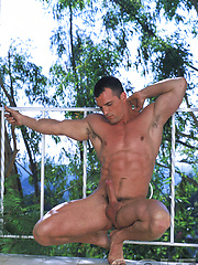 Tattoed hunky angel relaxing outdoor