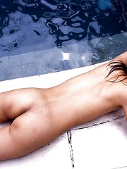 Adorable Asian model likes being naked and swimming
