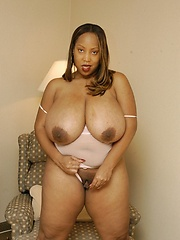 Huge chocolate milk juggs spill out of BBW\'s bra!