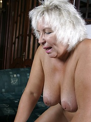 Fair-haired granny is pounded on the couch