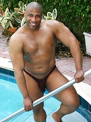 Muscle Hung is a dark, muscular man with a matching thick black cock