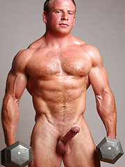 Strong bodybuilder training his body
