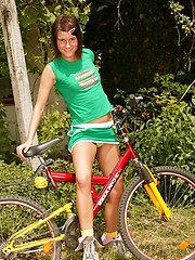 Hot sexy teenager on a bike stops for masturbation