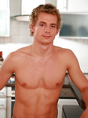 Curly stud Mark Huckleberry posing in the kitchen