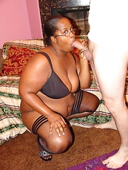 Interracial scene with an ebony bbw taking hard cock shoving and nasty cum hosing from a white guy